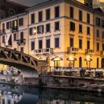 Bridge-across-the-Naviglio-Grande-canal-at-the-evening-in-Milan-Italy-shutterstock_316886099-2-1200×335