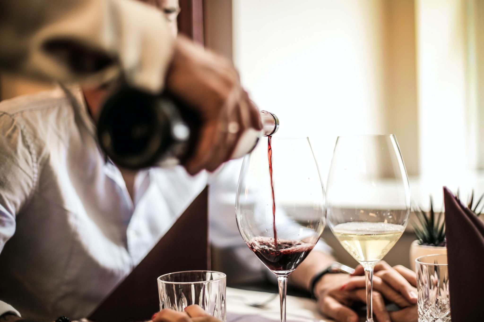 crop-man-pouring-red-wine-in-glass-in-restaurant-3756623