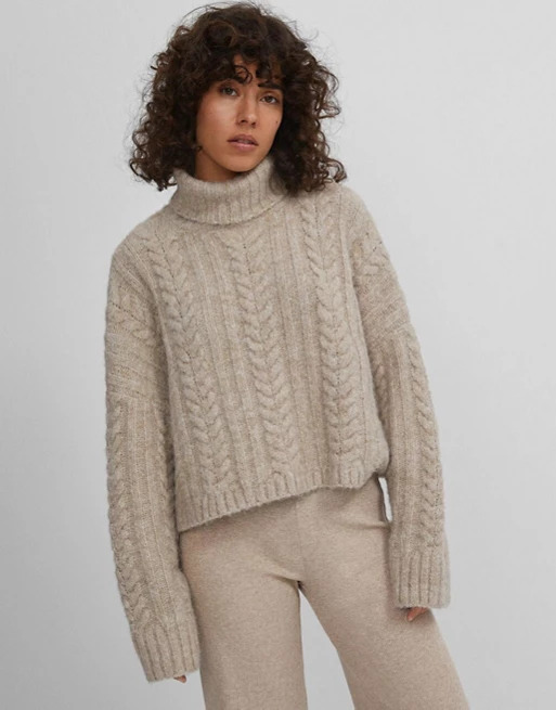 Recycled-polyester-high-neck-cable-knit-jumper-in-oatmeal_-Bershka_-£25.99