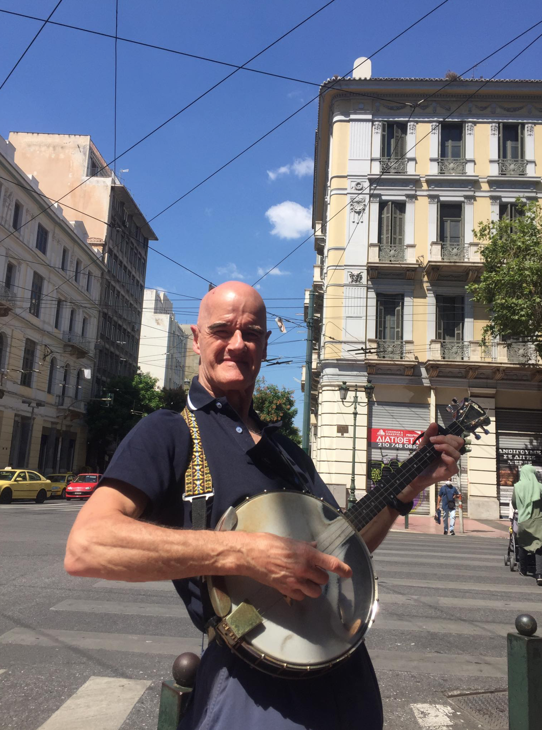 Alan Busking on the Streets of Athens (c) Tom Taylor