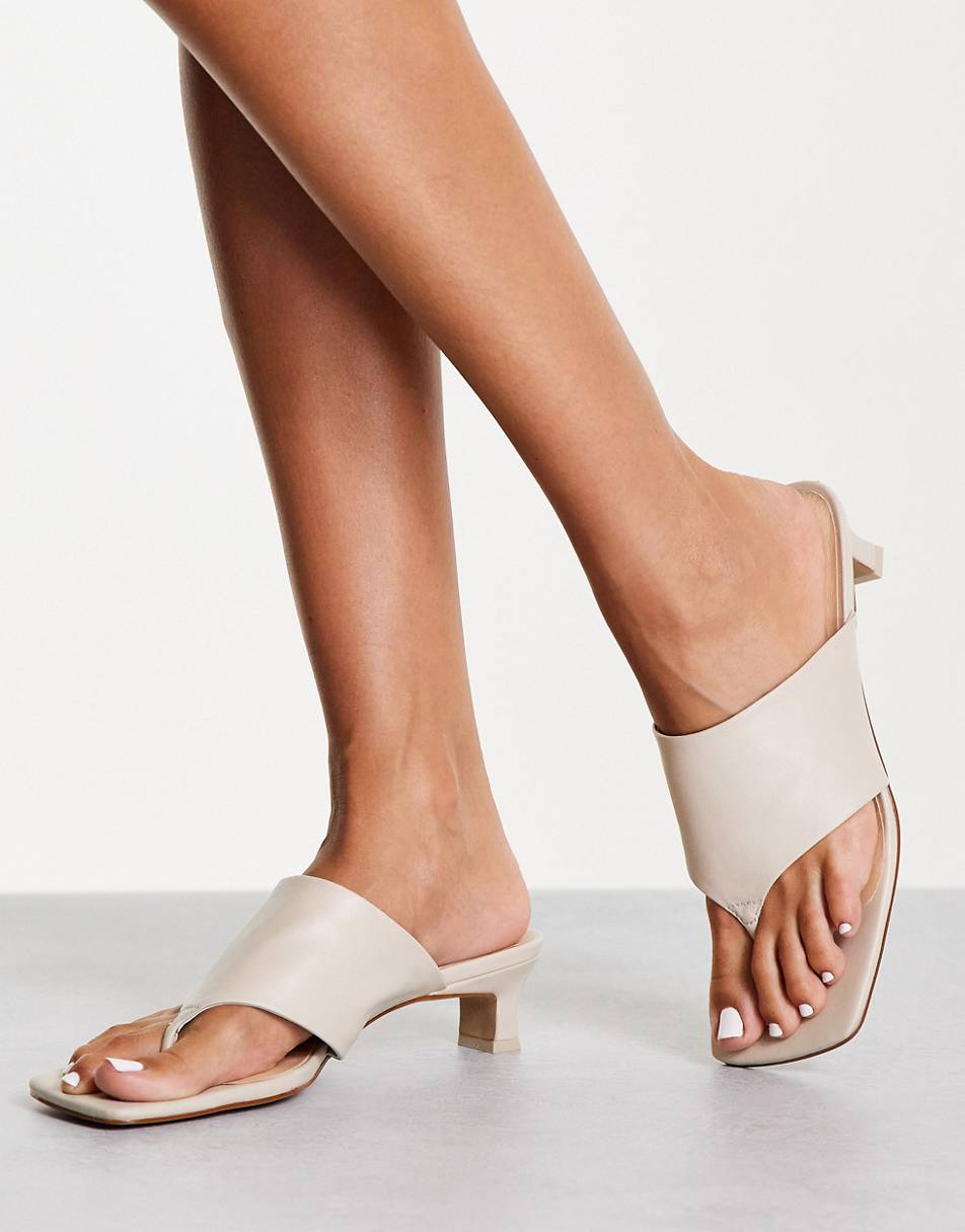 Christy toe thong heeled mules in ivory, E8 by Miista, £115.00