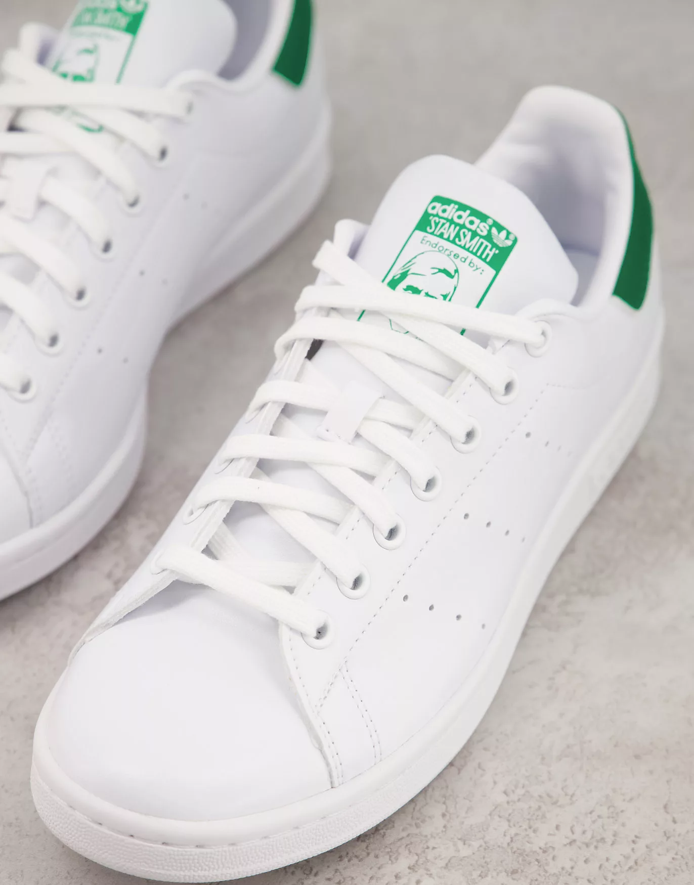 Sustainable Stan Smith trainers in white with green tab, adidas, £74.95